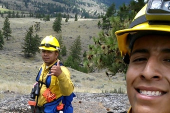 Noe Vasquez, right, on a state wildfire crew in the Okanogan Valley. After Vasquez lost his DACA status and his job, a traffic stop led to immigration custody.