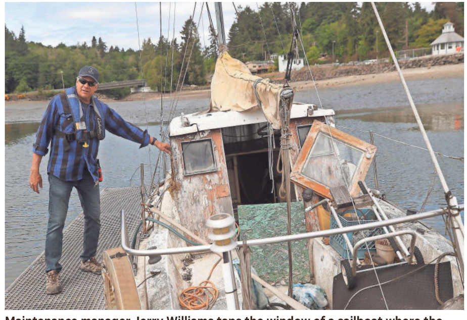 caption: Image and caption from previous Kitsap Sun reporting on abandoned boats in Puget Sound.