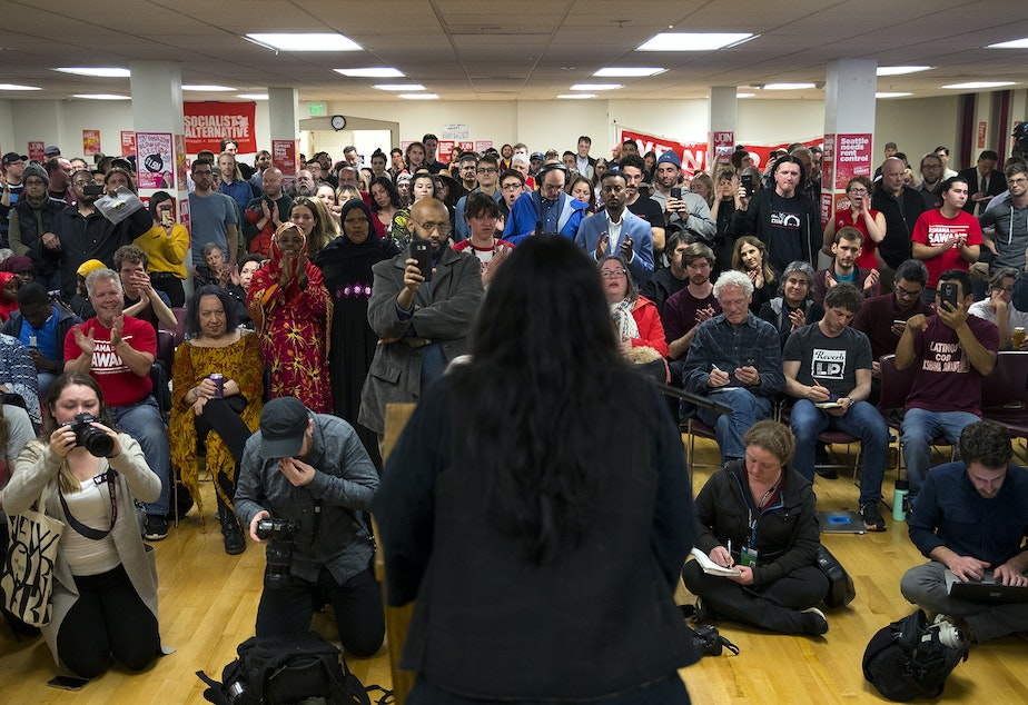 caption: Supporters clap for councilmember Kshama Sawant during an election night party on Tuesday, November 5, 2019, at Langston Hughes Performing Arts Institute in Seattle. Sawant trailed her District 3 opponent Egan Orion on election night but has closed the gap in later returns.