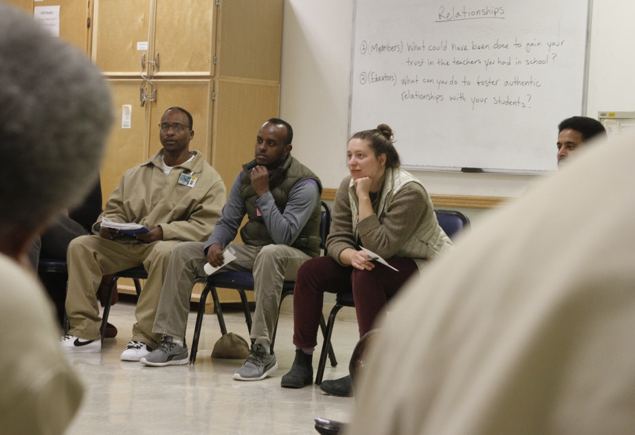 Teachers and inmates listen to each others' stories of school experiences good - and bad - at Monroe Correctional Complex on March 1, 2019.