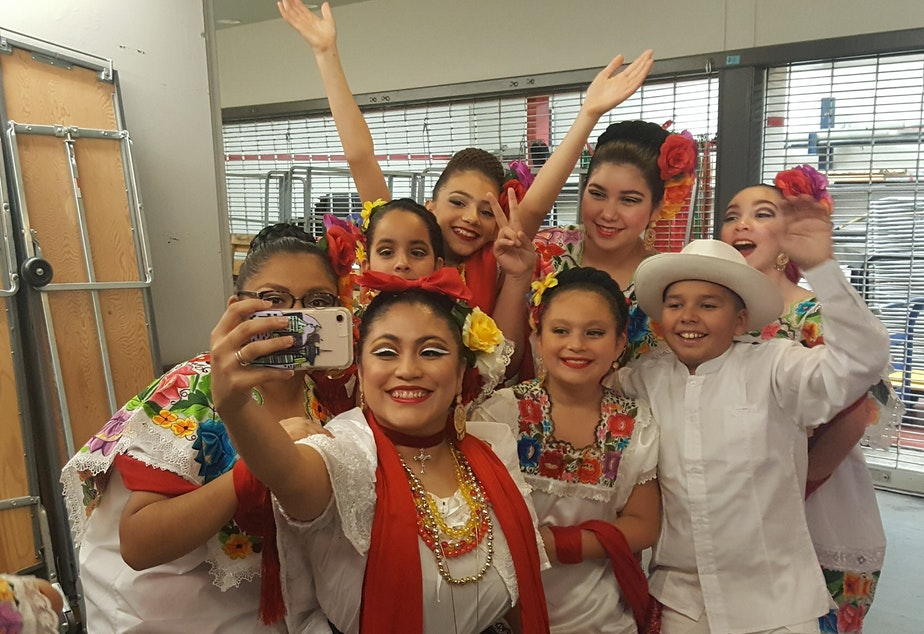 caption: Teacher Luna Garcia with Joyas Mestizas dancers