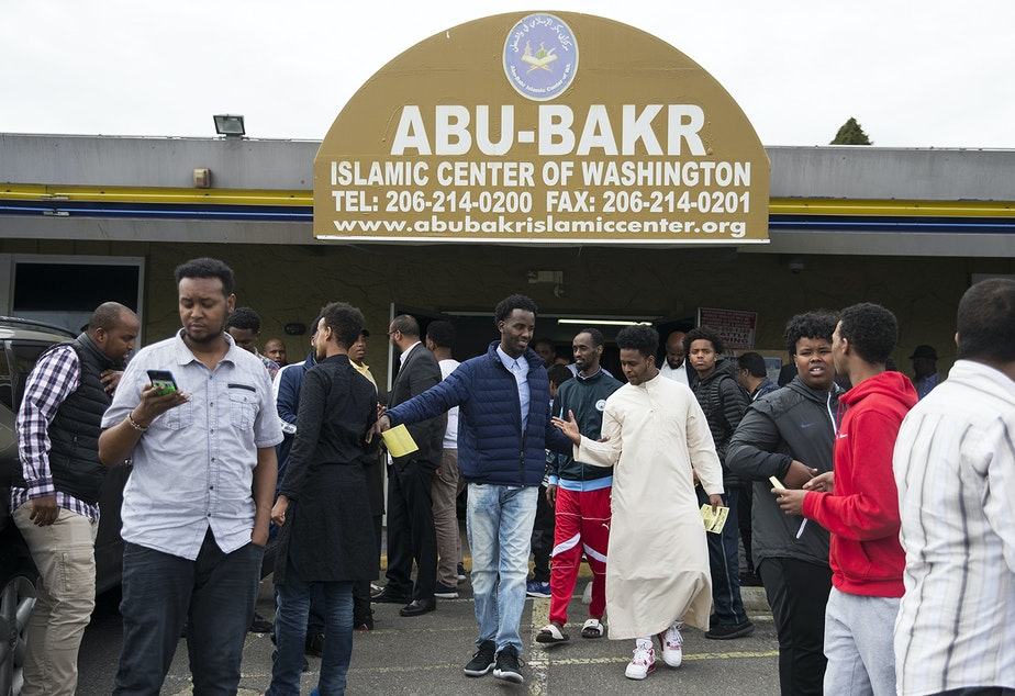 Men exit the Abu-Bakr Islamic Center after prayer on Friday, April 20, 2018, in Tukwila.