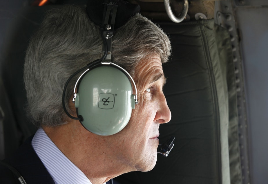FILE: Secretary John Kerry looks out over the city of Kabul from a helicopter after departing the U.S. Embassy on Tuesday, March 26, 2013.