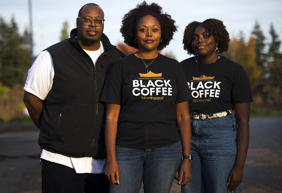 caption: From left, Erwin Weary Sr., Darnesha Weary and Mikayla Weary stand for a portrait on Thursday, October 15, 2020, outside of their new business, Black Coffee Northwest, along Aurora Avenue North in Shoreline.