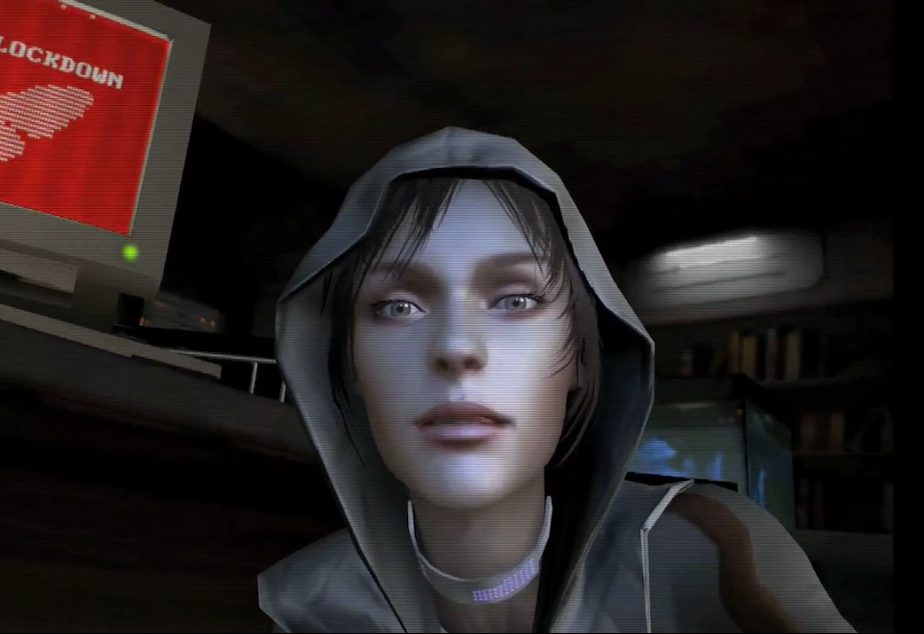 "caption: The new video game, ""Republique,"" begins with with a phone call from a woman named, Hope."