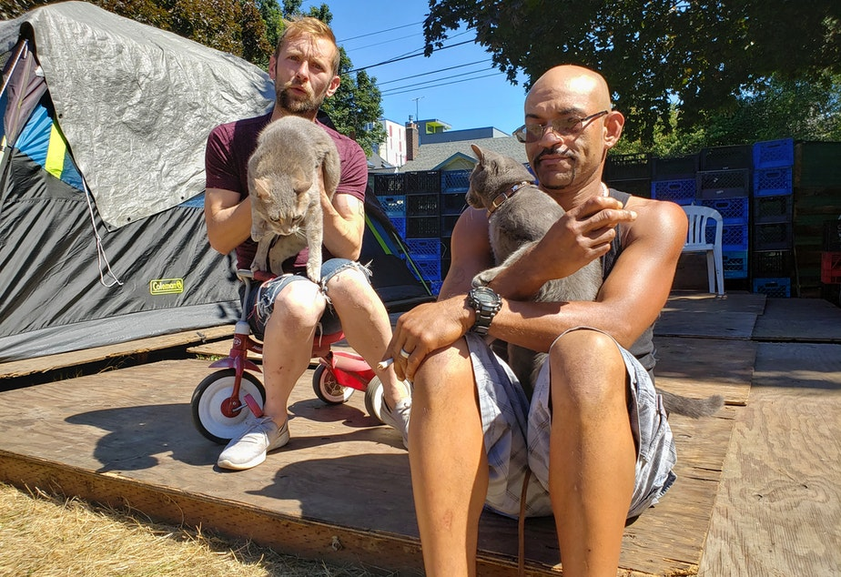 caption: Cassidy Katims (left) with his roommate's cat, Louie, and Mike Cleveland (right) with his cat, Mischief. Tent City 3 is home to many pets who will move to the new location in Tukwila.