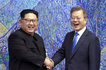 North Korean leader Kim Jong Un (left) poses with South Korean President Moon Jae-in in April at the border village of Panmunjom.