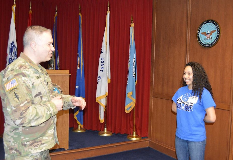 Commander Lt. Col. Vylius Leskys administers the enlistment oath to Levani Ilasa, the first woman in the country to enlist on a combat tank crew.