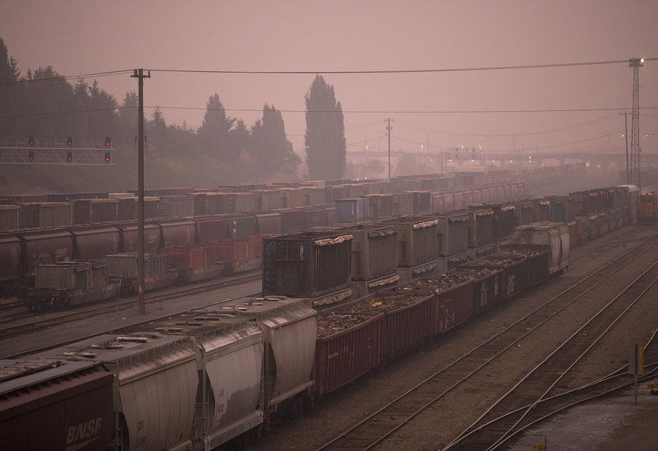 caption: Air quality in Seattle has turned hazardous according to the state Department of Ecology, as wildfire smoke from California and Oregon continues to settle in the area. Here, Balmer Yard is shown at sunrise on Saturday, September 12, 2020, in Seattle.