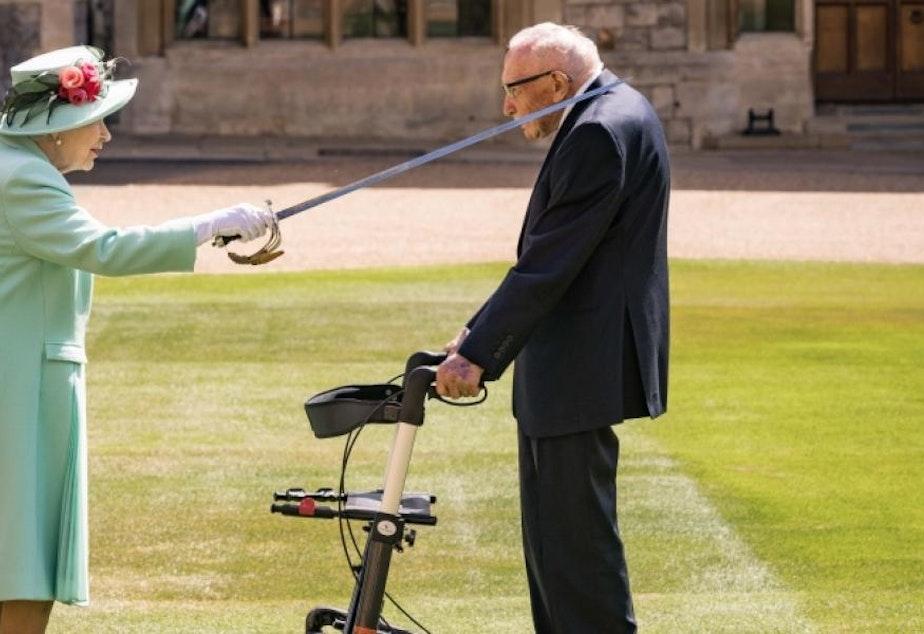 caption: In July, Queen Elizabeth conferred knighthood on World War II veteran Capt. Tom Moore at Windsor Castle.