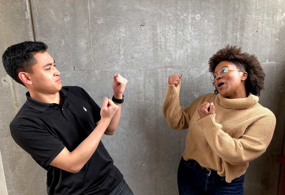 caption: Joe Santiago and Ishea Brown of KUOW's Curiosity Club pretend to fight at KUOW Public Radio station in Seattle on March 25, 2019.