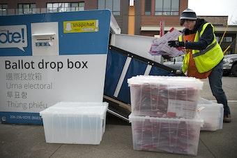 FILE: King County Elections employee Josephine Ruff unloads a  full ballot drop box outside of the Seattle Public Library in Ballard in November of 2017.