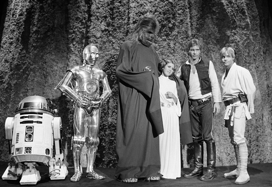 "FILE - In this Nov. 13, 1978 file photo, shows, from left, Kenny Baker, Anthony Daniels, Peter Mayhew, Carrie Fisher, Harrison Ford, and Mark Hamill during the filming of the CBS-TV special ""The Star Wars Holiday"" in Los Angeles. On Tuesday, Dec. 27, 2016, a publicist says Fisher has died at the age of 60."