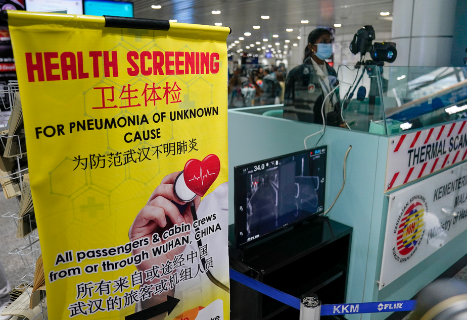 caption: Health officials watch thermographic monitors at a quarantine inspection station at the Kuala Lumpur International Airport in Sepang, Malaysia, Tuesday, Jan. 21, 2020.Countries both in the Asia-Pacific and elsewhere have initiated body temperature checks at airports, railway stations and along highways in hopes of catching those at risk of carrying a new coronavirus that has emerged out of China.