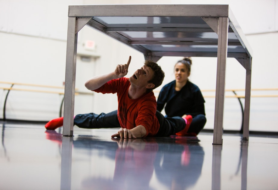 caption: Choreographer Olivier Wevers works with a dancer on one of his contemporary pieces.