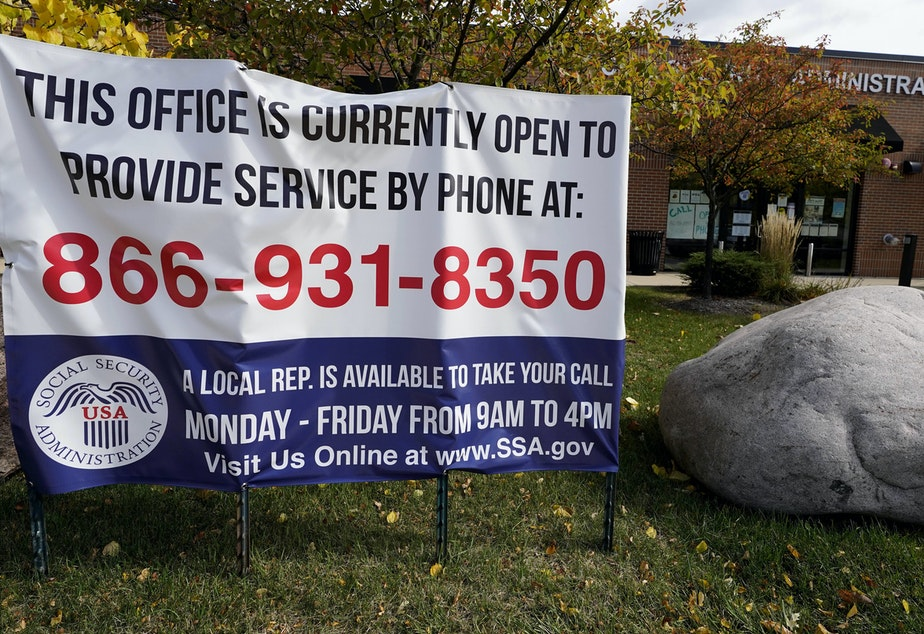 caption: A sign outside a U.S. Social Security Administration office in Mount Prospect, Ill., in October last year. Closed SSA offices across the country are being blamed for a 30 percent drop in applications for an aid program for the most vulnerable.
