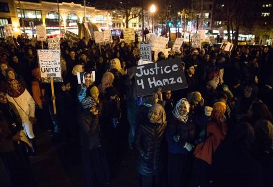 caption: People rally on Capitol Hill on Thursday in memory of Hamza Warsame, a 16-year-old Somali American who died in a fall from an apartment building.