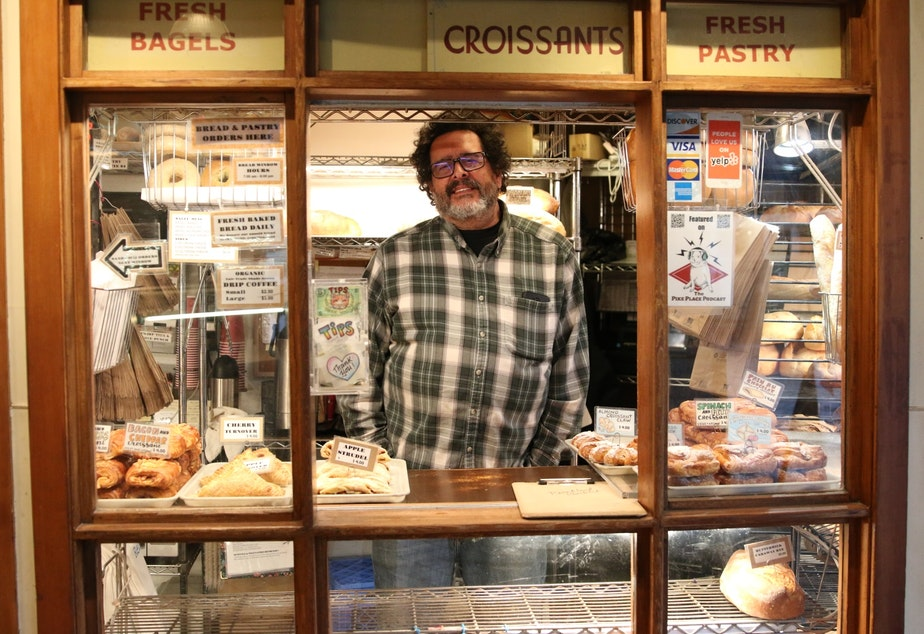 "caption: Jack Levy of Three Girls Bakery says things at the Pike Place Market are slow, but businesses there have been through World War 1, the Spanish Flu, The Great Depression, many recessions... ""We're going to be okay,"" he said."