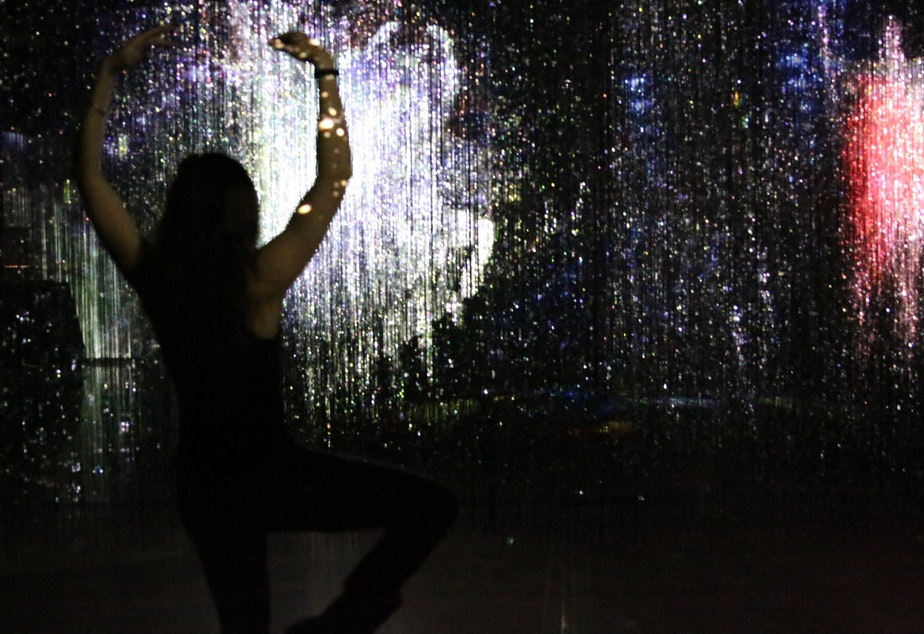 caption: Noah DuBose, Amazon employee and art lover at Mad Art Studio, near Amazon's Seattle headquarters