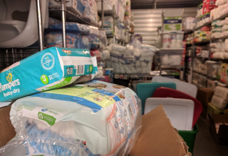 caption: The Babies of Homelessness storage unit in Bellevue is packed with donations for families in need.