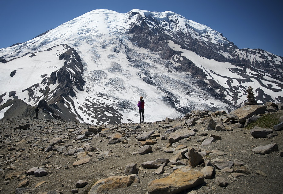 caption: Hikers stand along Burroughs Mountain Trail with a view of Mount Rainier on Saturday, July 20, 2019.