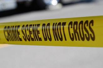 Two teenagers were arrested Wednesday night after a drive-by shooting fatally injured a woman working in a chiropractor's office.