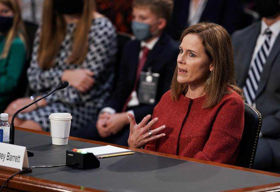 caption: President Trump's Supreme Court nominee Judge Amy Coney Barrett testifies during the second day of her Senate Judiciary confirmation hearing on Tuesday.