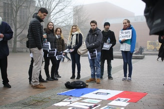 A small gathering at Red Square to discuss the events that have unfolded in Paris.
