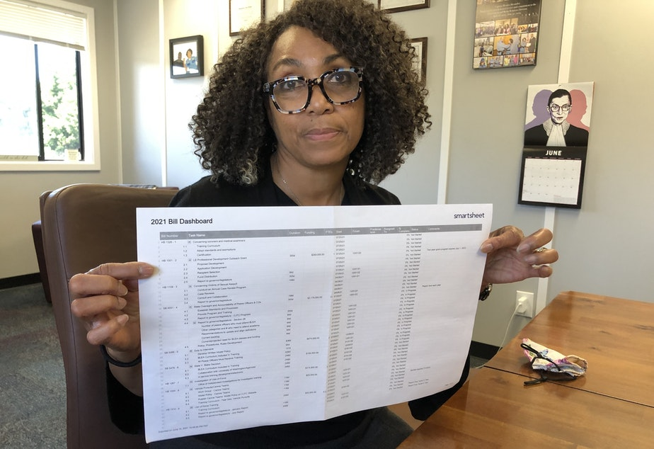 caption: Criminal Justice Training Commission director Monica Alexander uses a spreadsheet to track all of the state's new police reform legislation.