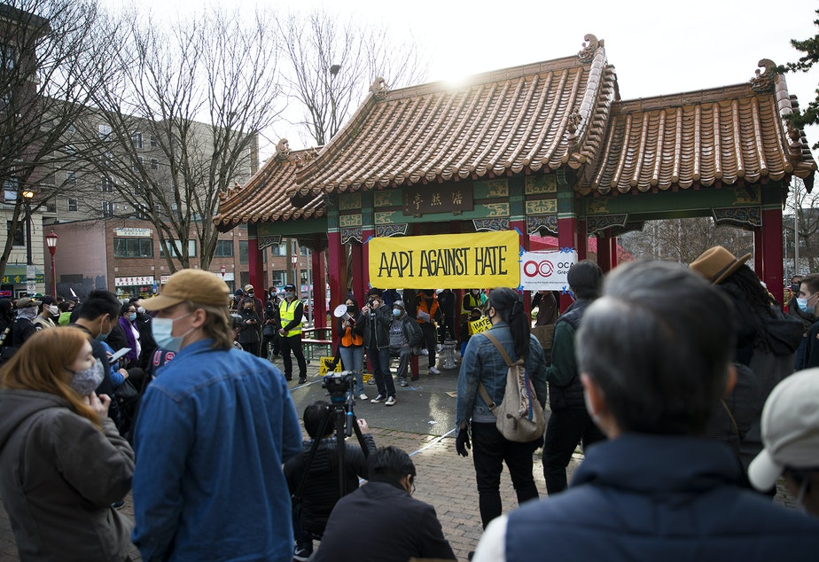 caption: Hundreds gathered for the 'We Are Not Silent' rally against anti-Asian hate and violence on Saturday, March 13, 2021, at Hing Hay Park in Seattle. Several days of actions are planned by rally organizers in the Seattle area following recent attacks and violence against Asian Americans and Pacific Islanders.