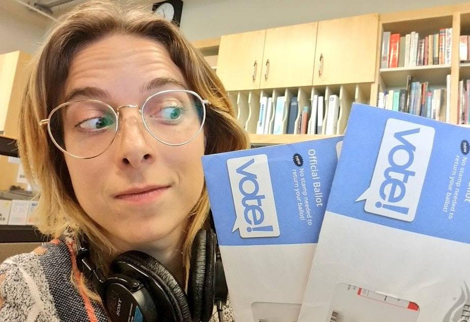 caption: KUOW newscaster Paige Browning with the two ballots she received.