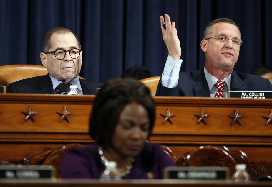 House Judiciary Committee ranking member Rep. Doug Collins, R-Ga., gestures during his opening statement while sitting next to Judiciary Committee Chairman Jerry Nadler of New York.