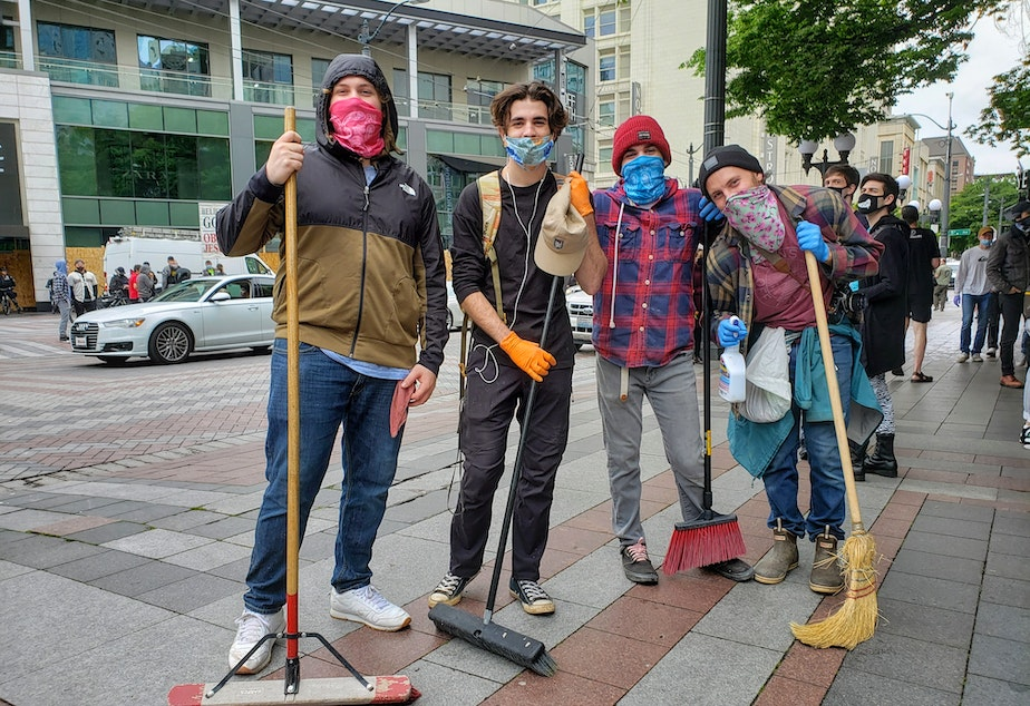 caption: From left: Lad, Dorian, Quinten, and Oliver Issa joined dozens of volunteers to cleanup downtown on Sunday, May 31st, 2020.