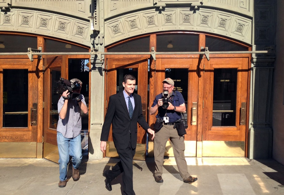 caption: Former WA State Auditor Troy Kelley leaves the federal courthouse in Tacoma in 2016. Kelley's attorney says he plans to ask the U.S. Supreme Court to review Kelley's conviction.