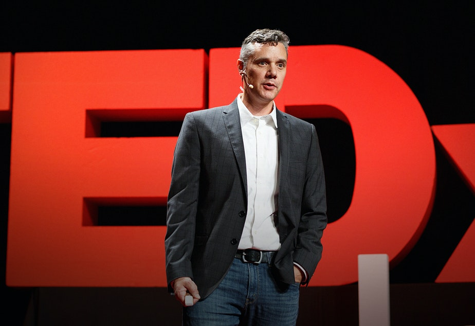 caption: Ryan Martin on the TED stage.