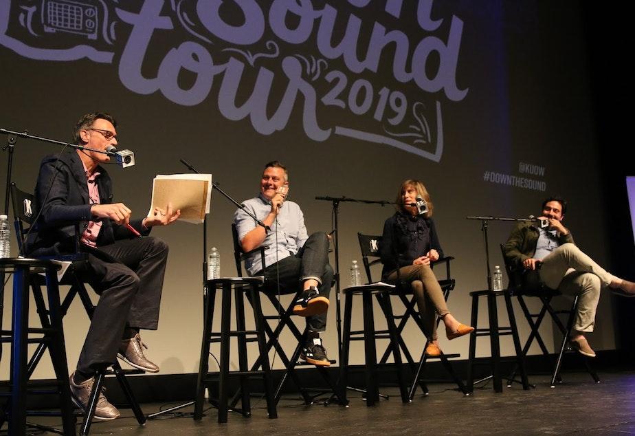 caption: Bill Radke, Luke Burbank, Joni Balter, and Antonio García Martínez at the Mount Baker Theatre in Bellingham recording live for Week In Review Live.