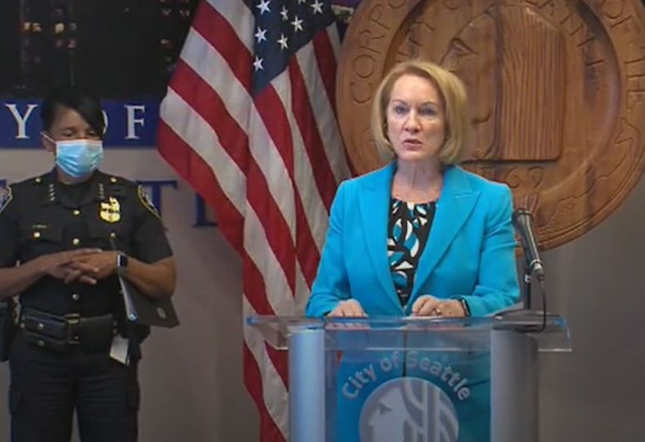 caption: Seattle Mayor Jenny Durkan, along with Police Chief Carmen Best, announce their proposal to reorganize the police department, reducing its size and funding, July 13, 2020.