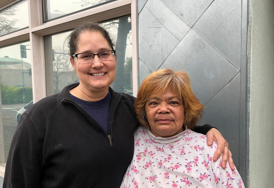 caption: Tenant advocates Sarah Stewart (left)  and Gina Owens say they want to prevent bias in the rental process. Landlords say Seattle laws are driving them away.