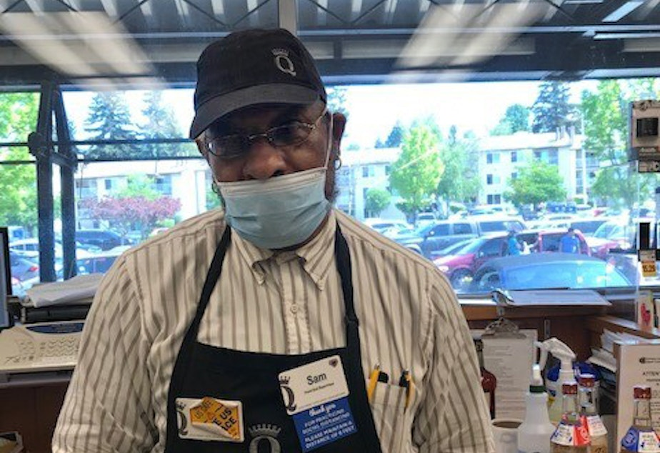 caption: Sam Dancy at the Westwood Village QFC. He has been working in the grocery industry for three decades.