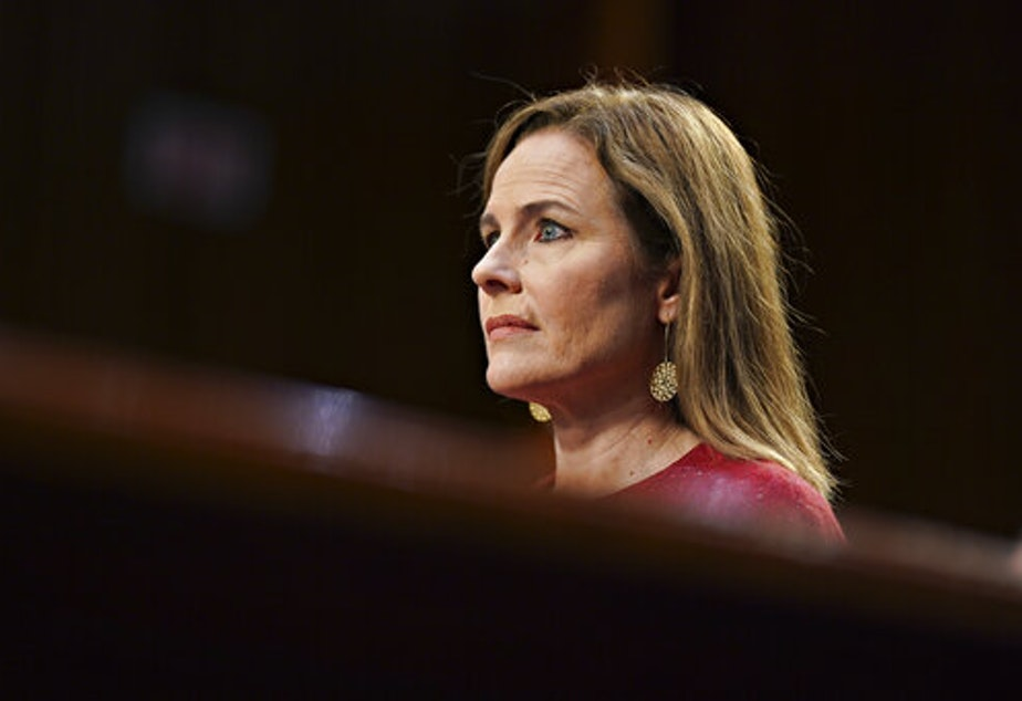 caption: Supreme Court nominee Amy Coney Barrett listens during a confirmation hearing before the Senate Judiciary Committee, Tuesday, Oct. 13, 2020, on Capitol Hill in Washington.