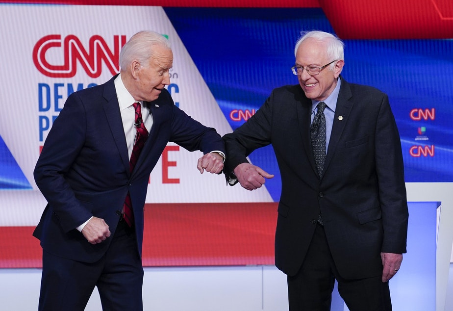 caption: Former Vice President Joe Biden (left) and Sen. Bernie Sanders, I-Vt., greet one another before they participate in a Democratic presidential primary debate.
