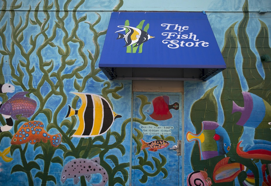 A mural painted by Lynn DeBeal is shown on Thursday, December 6, 2018, on the backside of The Fish Store on Lake City Way Northeast in Seattle.