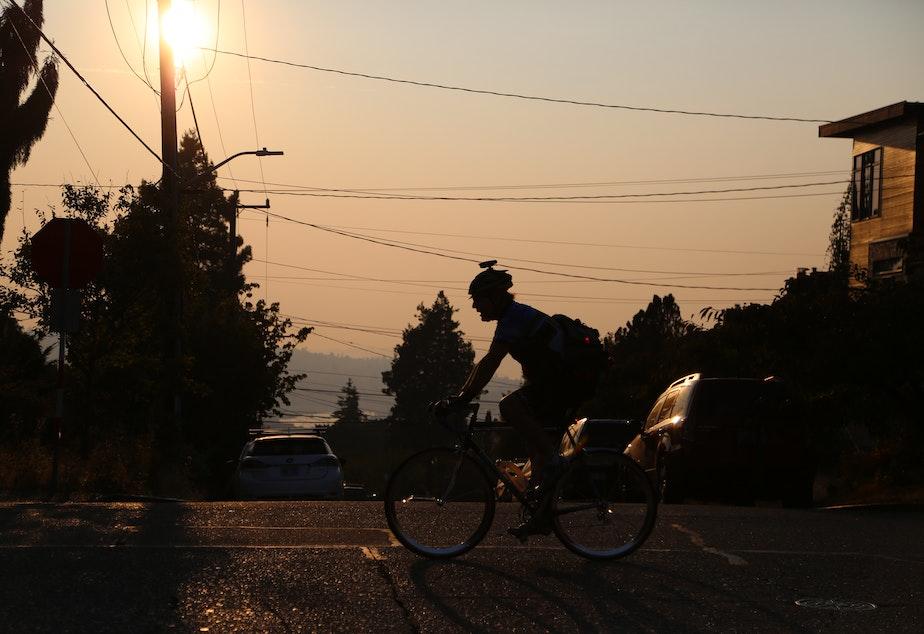 caption: Biker crossing the street in Seattle September 10, 2020