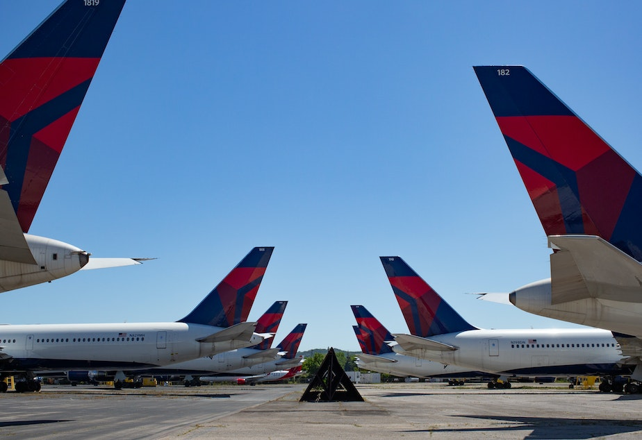 caption: Dozens of Delta jets have been parked on the tarmac of the Birmingham-Shuttlesworth International Airport since last spring. The airline reported $5.4 billion in third quarter losses on Tuesday.