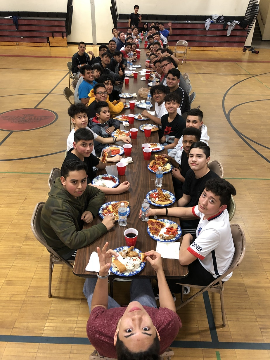 caption: Every first Friday of the month, members of Los Siete get together in Chinook Middle School's gym.