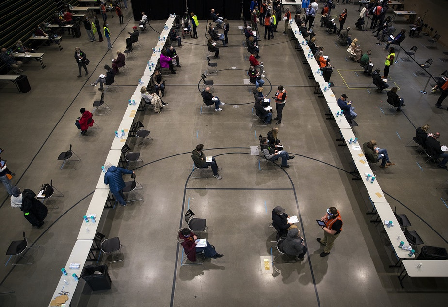 caption: People wait for 15 minutes after receiving the first dose of the Pfizer-BioNTech Covid-19 vaccine on Sunday, January 24, 2021, during a one-day pop up Covid-19 vaccine clinic at Amazon's headquarters in Seattle.