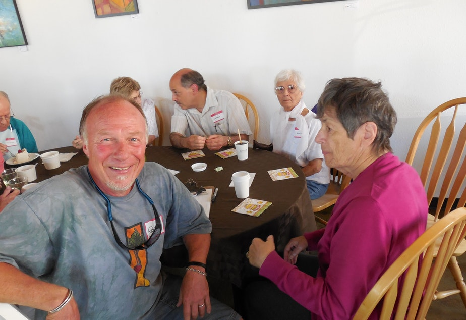 caption: Roger Stocker joins a gathering at the Greenwood Alzheimer's Cafe. He was diagnosed with dementia three years ago.