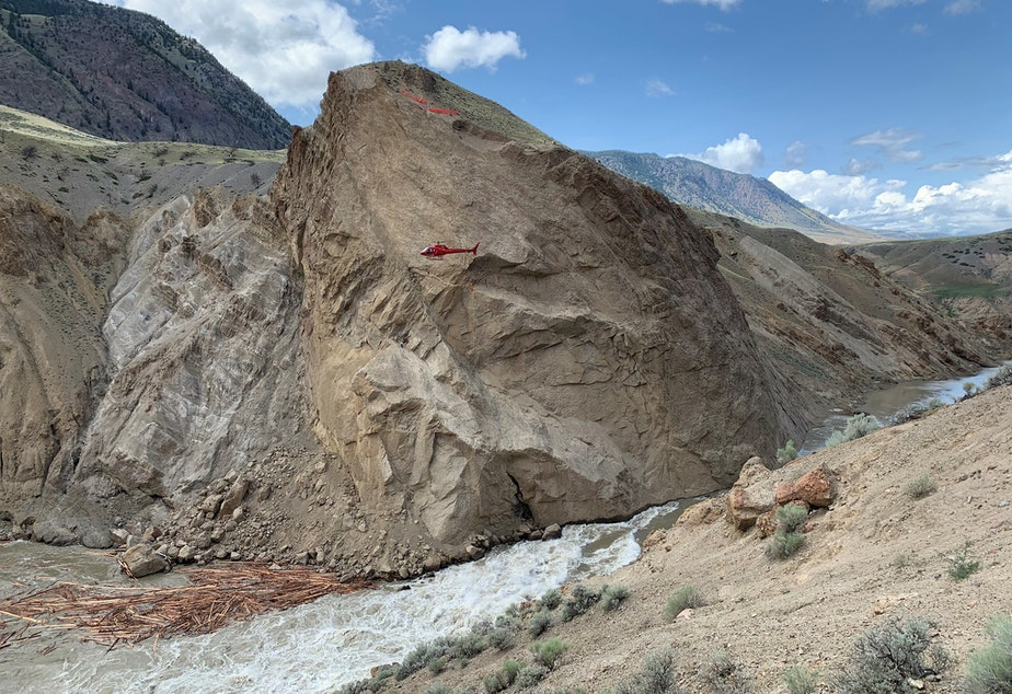 A helicopter (see it?) hovers above the site of a rockslide and partial blockage of Canada's Fraser River.