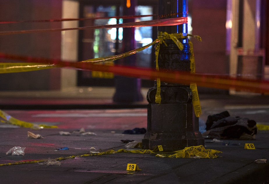 caption: The intersection of Third Avenue and Pine Street is secured with caution tape following a shooting that left multiple victims injured and one dead on Wednesday, January 22, 2020, in Seattle.