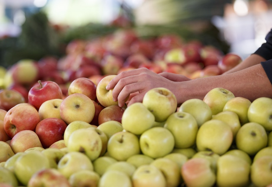 caption: In this photo taken Oct. 5, 2014, apples are displayed at a farmers market in Arlington, Va. A common pesticide used on citrus fruits, almonds and other crops would be banned under a proposal announced Friday by the Environmental Protection Agency. The proposal would prohibit use of chlorpyrifos, a widely used insecticide that is sprayed on a variety of crops including oranges, apples, cherries, grapes, broccoli and asparagus.